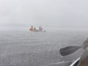 Scouts Grant Lemen, Sam Iles and guide Cody Loucks paddle during the beginning of a storm that threatened the lives of a West Chester Boy Scout troop.(photo from Cincinnati .com