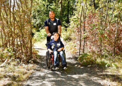 Jonathan Fillmore, of North Providence, and his son Jonathan Jr., who just signed up last week with the Scouts, take advantage of a special trail built by the Scouts and the Appalachian Mountain Club that is designed to be handicapped-accessible.